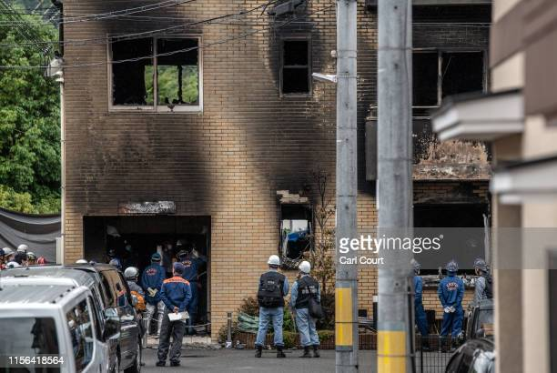 Emergency service personnel inspect the Kyoto Animation Co studio building following an arson attack, on July 19, 2019 in Kyoto, Japan. Thirty three...