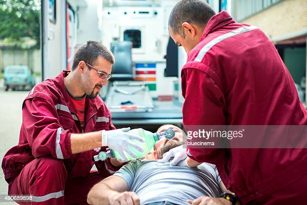 emergency service rescuing an infarcted - respiratory machine stock photos and pictures
