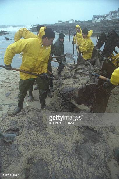 Emergency service workers help volunteers clean up the beaches