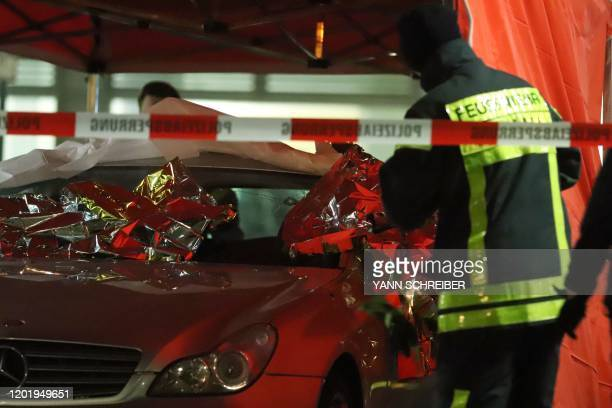 TOPSHOT Emergency services and police work at the scene of a shooting in Hanau western Germany on February 20 2020 At least eight people were killed...