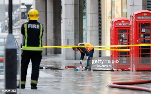 Emergency services and utilities personnel work at the scene of a gas leak on the Strand in central London on January 23 2018 Almost 1500 people were...
