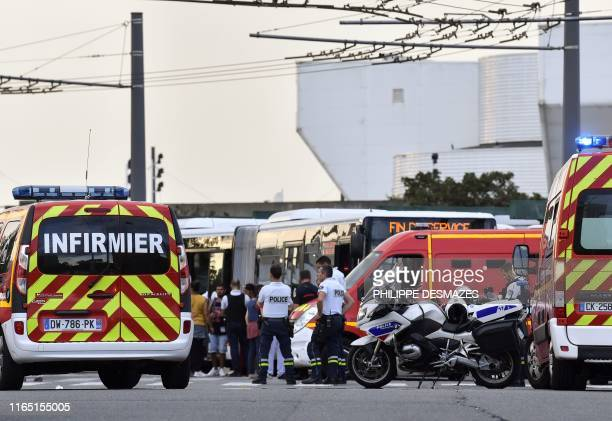 TOPSHOT Emergency services are at work in Villeurbanne on the outskirts of Lyon southeastern France on August 31 after a knife attack which has left...
