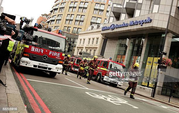 Emergency services are seen outside the Hilton hotel on Edgware Road following a series of explosions which have ripped through London's tube network...