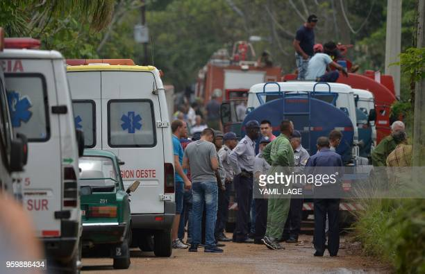 Emergency services arrive at the scene of the accident after a Cubana de Aviacion aircraft crashed after taking off from Havana's Jose Marti airport...
