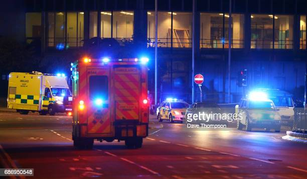 Emergency services arrive close to the Manchester Arena on May 23 2017 in Manchester England There have been reports of explosions at Manchester...