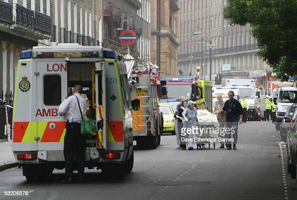 Emergency Services assist a victim at the scene near Russell Square underground station after a series of explosions ripped through London's...