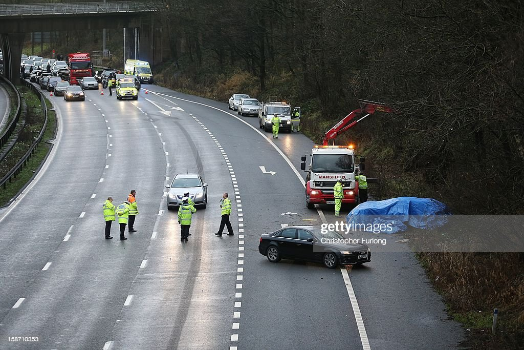 Emergency services attend the aftermath of a serious motor accident between Junctions 14 and 15 on the M6 motorway on December 25, 2012 between Stafford and Stoke-on-Trent, England. West Midlands Ambulance service are reporting that three children died in the accident and two women are left critically injured.