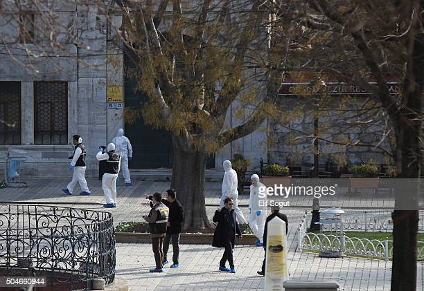 Emergency services attend the scene after an explosion in the central Istanbul Sultanahmet district on January 12 2016 in Istanbul Turkey At least 10...