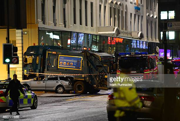 Emergency services attend the scene near a cordon off crashed bin lorry in George Square on December 22 2014 in Glasgow Scotland There are reports of...