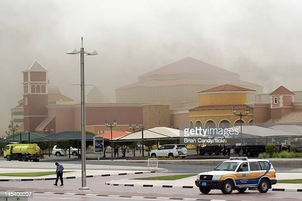 Emergency services attend the scene of a fire at the Villaggio mall on May 28 2012 in Doha Qatar A fire started at the Villaggio mall shopping centre...