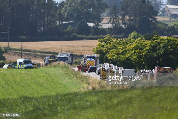 """Emergency services attend the scene of a train derailment on August 12, 2020 in Stonehaven, Scotland. Police Scotland said: """"A report was received of..."""