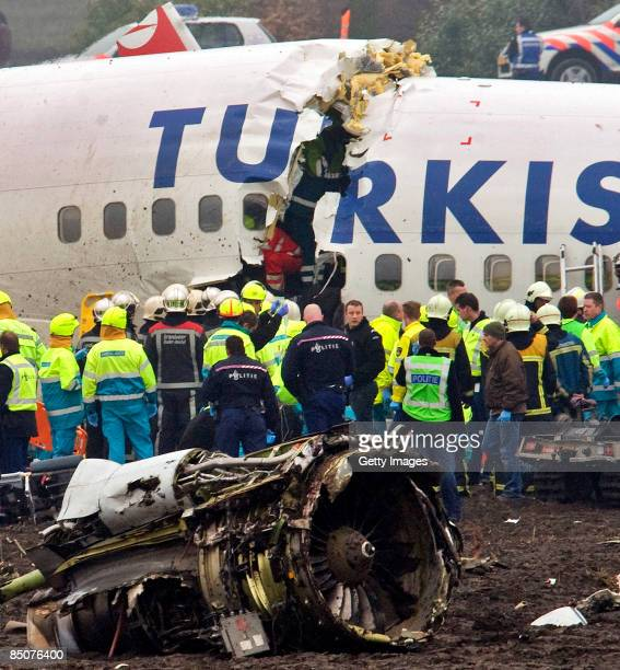 Emergency services attend to the scene of a Turkish Airlines Boeing 737-800 plane which crashed on landing at Schiphol airport on February 25, 2009...