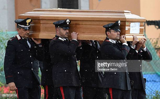Emergency services carry a coffin during a mass funeral for victims of the recent earthquake on August 30 2016 in Amatrice Italy Italy has declared a...