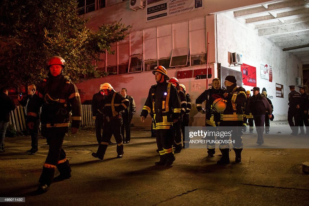 Emergency services gather near a club in Bucharest October 31, 2015, after an explosion. More than 20 people died and dozens were injured in an explosion followed by a fire, which took place Friday evening at a club during a music concert , where at that time there were hundreds people. Romanian Interior Minister, Gabriel Oprea announced that there are at least 26 dead.