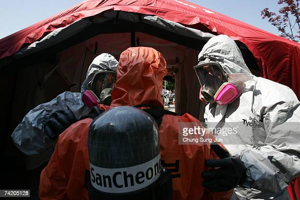 Emergency services in chemical protection clothing participate in an antichemical and biochemical terror exercise on May 21 2007 in Seoul South Korea...