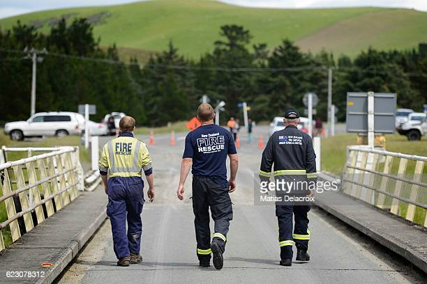 Emergency services inspect a bridge crossing the Waiau River in Rotherham Road 110 kms north of Christchurch as damage and land slip cause...