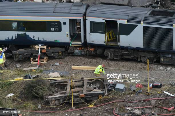 Emergency services inspect the scene near Stonehaven, Aberdeenshire, following the derailment of the ScotRail train which cost the lives of three...