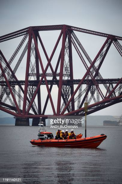 Emergency services keep watch as participants take part in the annual New Year's Day Loony Dook swim in the Firth of Forth in South Queensferry near...