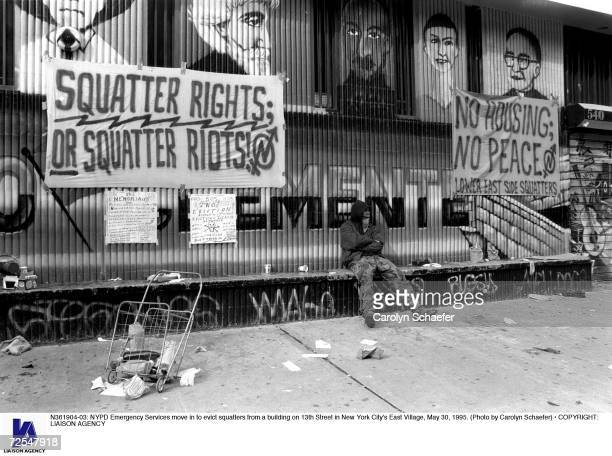 Emergency Services move in to evict squatters from a building on 13th Street in New York City's East Village May 30 1995