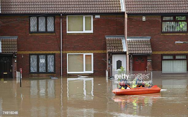 Emergency services patrol the streets in a dinghy as floodwater subsides in the Catcliffe area of Rotherham half a mile from the cracked Ulley Dam on...