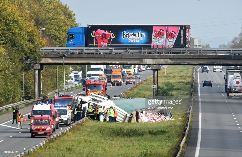 Emergency services personnel gather at the scene of a road accident ...