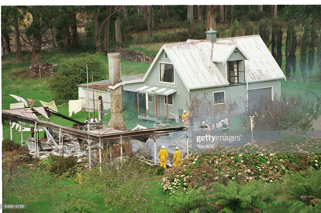 Emergency services personnel in the ruins of the Seascape Guesthouse where gunman Martin Bryant retreated after shooting and killing 35 people during the Port Arthur massacre, before being apprehended, 29 April 1996. THE AGE Picture by JASON