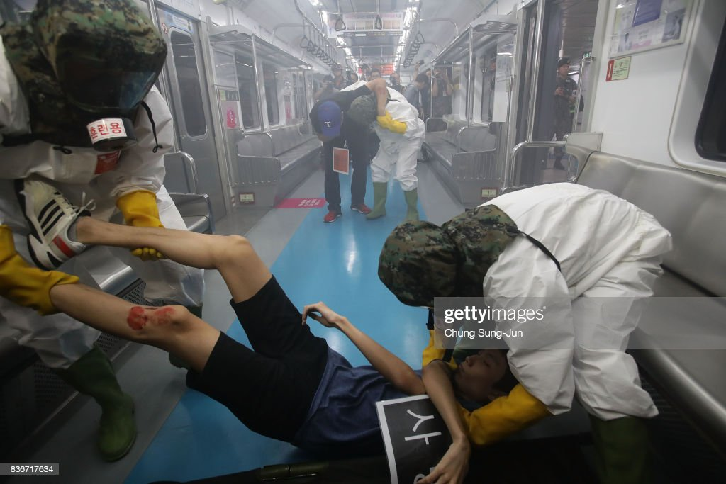Emergency services personnel wearing protective clothing participate in an anti-terror and anti-chemical terror exercise as part of the 2017 Ulchi Freedom Guardian (UFG) at subway station on August 22, 2017 in Seoul, South Korea. The computer simulation war game exercises may cause further tension between Pyongyang and Washington.