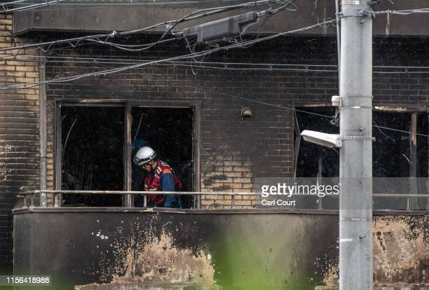 Emergency services personnel work at the Kyoto Animation Co studio building after an arson attack on July 19, 2019 in Kyoto, Japan. Thirty three...