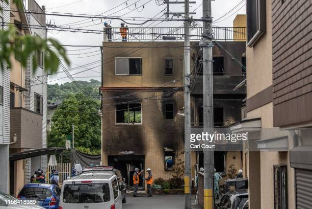 Emergency services personnel work at the Kyoto Animation Co studio building after an arson attack on July 19 2019 in Kyoto Japan Thirty three people...