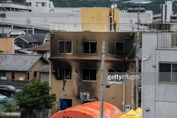 Emergency services personnel work at the Kyoto Animation Co studio building after an arson attack, on July 19, 2019 in Kyoto, Japan. Thirty three...