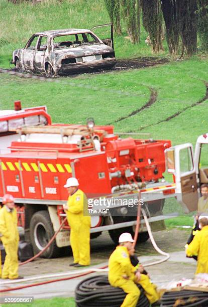 Emergency services personnel work at the site at the Seascape Guesthouse which was burnt down during the Port Arthur massacre A burnt out BMW...