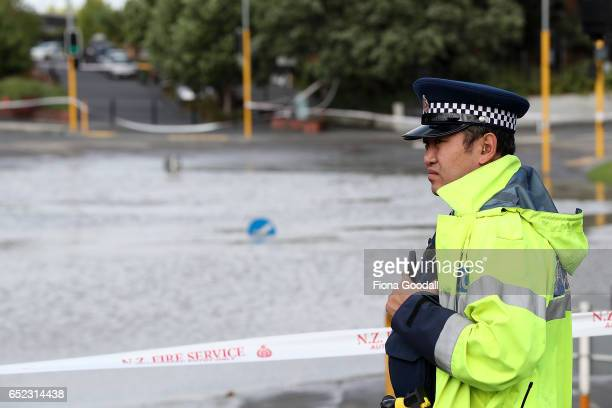 Emergency services respond as Great North Road in New Lynn is closed due to extensive flooding on March 12 2017 in Auckland New Zealand The Tasman...