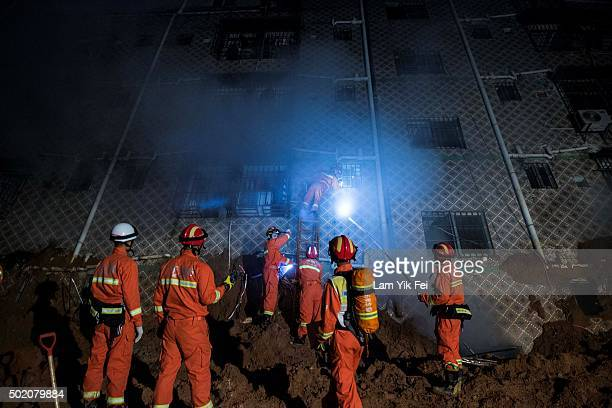 Emergency services search a collapsed building after a landslide buried 22 buildings on December 20 2015 in Shenzhen China Reports say at least 27...