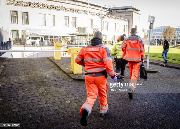 Emergency Services staff run near the International Criminal Tribunal for the former Yugoslavia in The Hague on November 29 2017 The United Nations...
