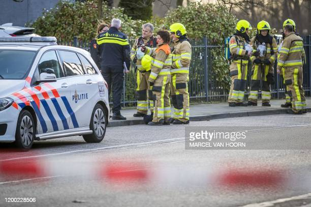 Emergency services stand outside a postal sorting company after a bomb letter is believed to have detonated in the mail room in the southern city of...
