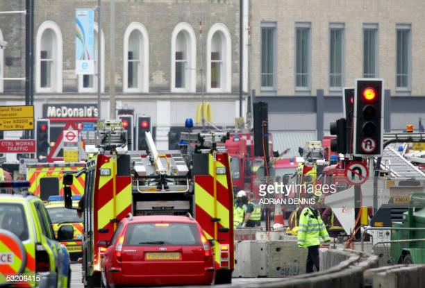 Emergency services surround Kings Cross station after a terrorist attack in London 07 July 2005 Police said they believed at least two people had...