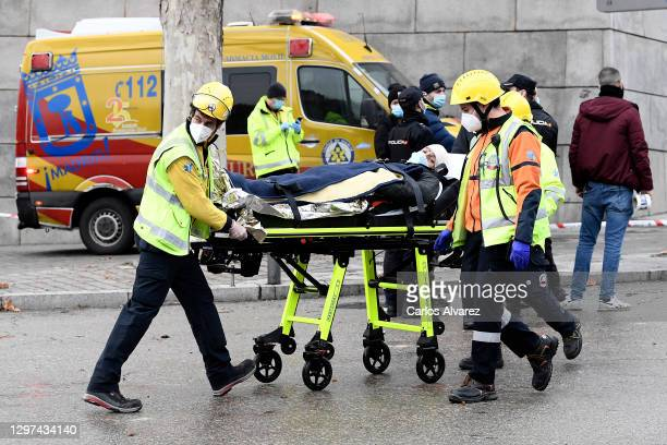 Emergency services take away an injured man on a stretcher after six floors collapsed on a building after a large explosion on Toledo Street in...