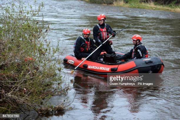 Emergency services use an under water camera as they search for Ian Bell an eightyearold boy who is believed to have fallen into a rainswollen River...