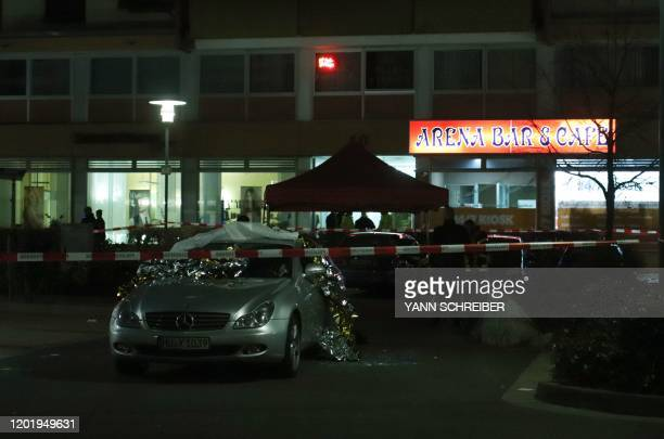 Emergency services work at the scene of a shooting in Hanau western Germany on February 20 2020 At least eight people were killed in two shootings...