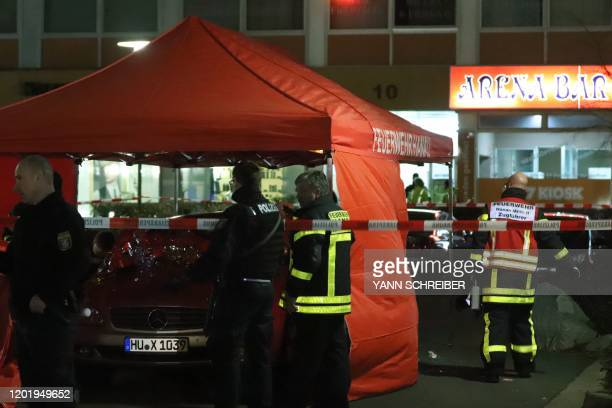 TOPSHOT Emergency services work at the scene of a shooting in Hanau western Germany on February 20 2020 At least eight people were killed in two...