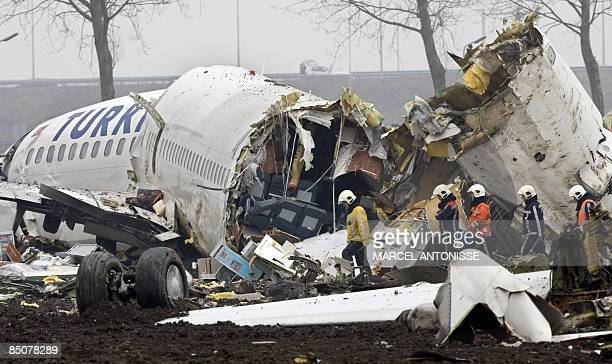 Emergency services work at the scene of a Turkish Airlines passenger plane which crashed on February 25, 2009 while landing at Schiphol airport in...