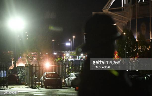 Emergency services work at the scene on the wreckage of a helicopter that crashed in a car park outside Leicester City Football Club's King Power...