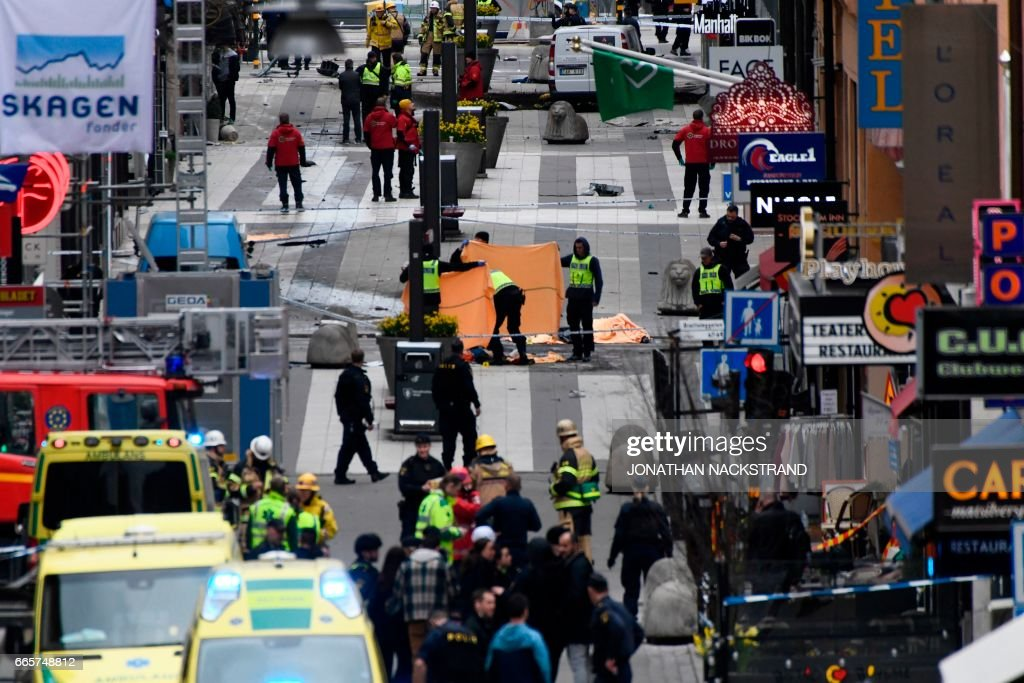 TOPSHOT - Emergency services work at the scene where a truck crashed into the Ahlens department store at Drottninggatan in central Stockholm, April 7, 2017. PHOTO / Jonathan NACKSTRAND