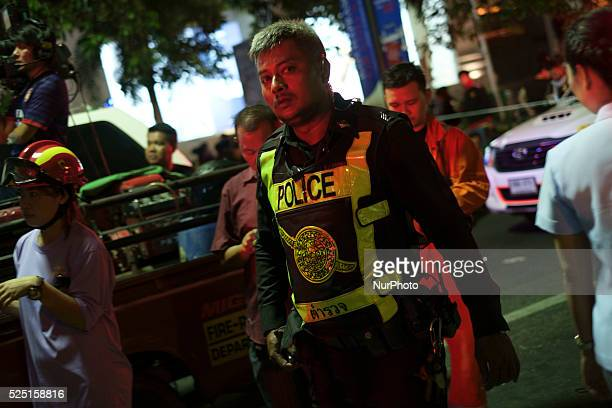 Emergency services workers collect evidence at the scene of an explosion on August 17, 2015 in Bangkok, Thailand. At least 16 people were killed and...