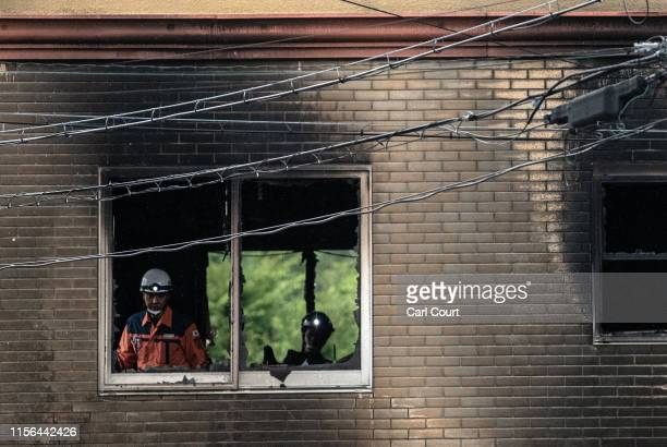 Emergency services workers inspect a room inside the Kyoto Animation Co studio building after an arson attack, on July 19, 2019 in Kyoto, Japan....