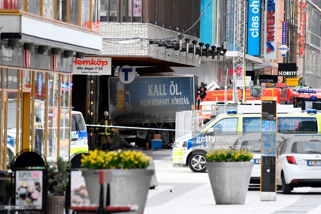 TOPSHOT - Emergency servies work at the scene where a truck crashed into the Ahlens department store at Drottninggatan in central Stockholm, April 7, 2017. PHOTO / Jonathan NACKSTRAND