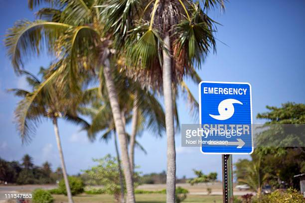 emergency shelter sign on little cayman island - emergency shelter stock pictures, royalty-free photos & images