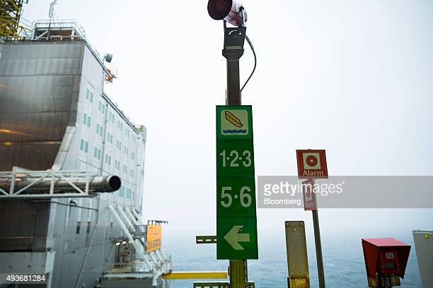 Emergency signs for boat evacuation and alarms sit on an exterior walkway aboard the Troll A natural gas platform operated by Statoil ASA in the...