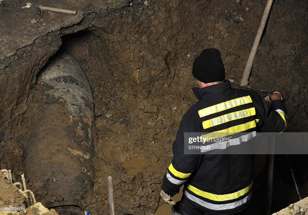 Emergency situations personnel work at the site where an unexploded bomb, of 'great destruction power' dating back to World War II, was found late on December 7, 2013, in downtown Belgrade. The bomb was removed overnight from downtown Belgrade and moved to a military polygon for detonation, authorities said. The one-ton German bomb containing 620 kgs (1,370 lbs) of explosive was found during construction works in the central Belgrade area of Dorcol, forcing the authorities to evacuate some 20 inhabitants from the next building. On April 6, 1941 Belgrade was heavily bombed by German aircraft at the beginning of four-year occupation.