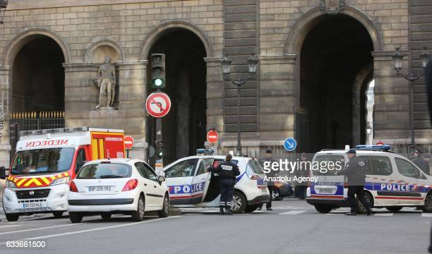 Emergency squads wait at the scene as the police take security measures in front of the Louvre Museum after a soldier shot and wounded a man in Paris...